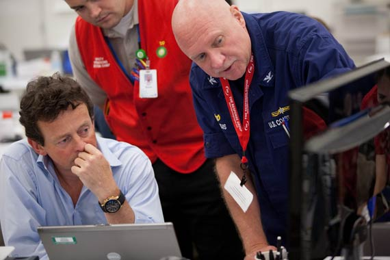 BP Group Chief Executive Tony Hayward discusses the operation with a US Coast Guard