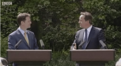 Prime Minister David Cameron and Deputy Prime Minister Nick Clegg seal their relationship in public as this still from the BBC News website shows