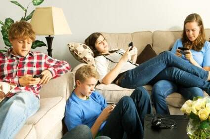 Teenagers using smartphones