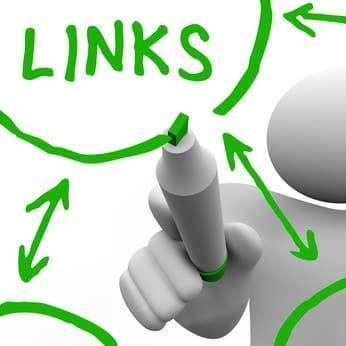 A person draws a series of links connecting in a network of referrals, representing a well search engine optimized website or an organization of connected people
