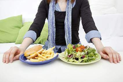Person choosing between salad or burger