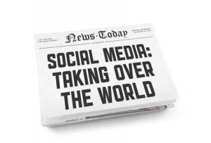 "A stack of newspapers with headline ""Social media: Taking over the world"". Isolated on white."