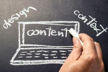 Hand sketching laptop and writing website content words for business