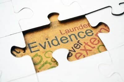 "Jigsaw puzzle with word ""evidence"""