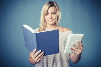 Woman with book and ebook