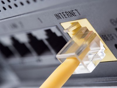 Network yellow cable connected to a router or modem