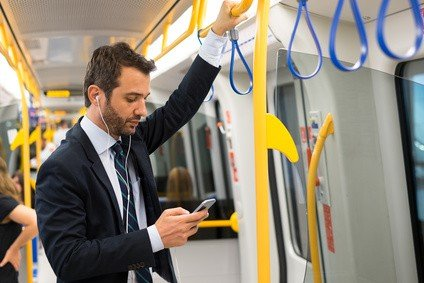 Man using phone on underground train