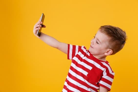 Child taking selfie