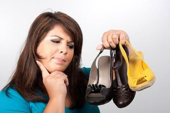 Woman choosing between different shoes depends on decision-making styles