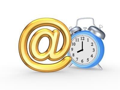 Email sign beside a clock