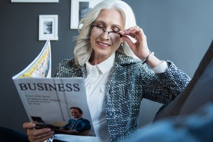 Woman reading business magazine