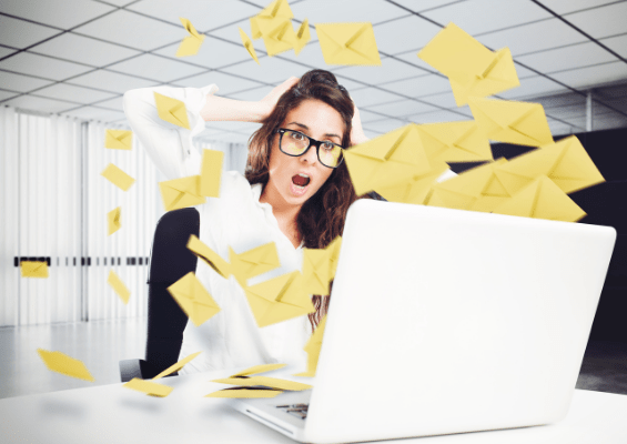 Woman surrounded by emails